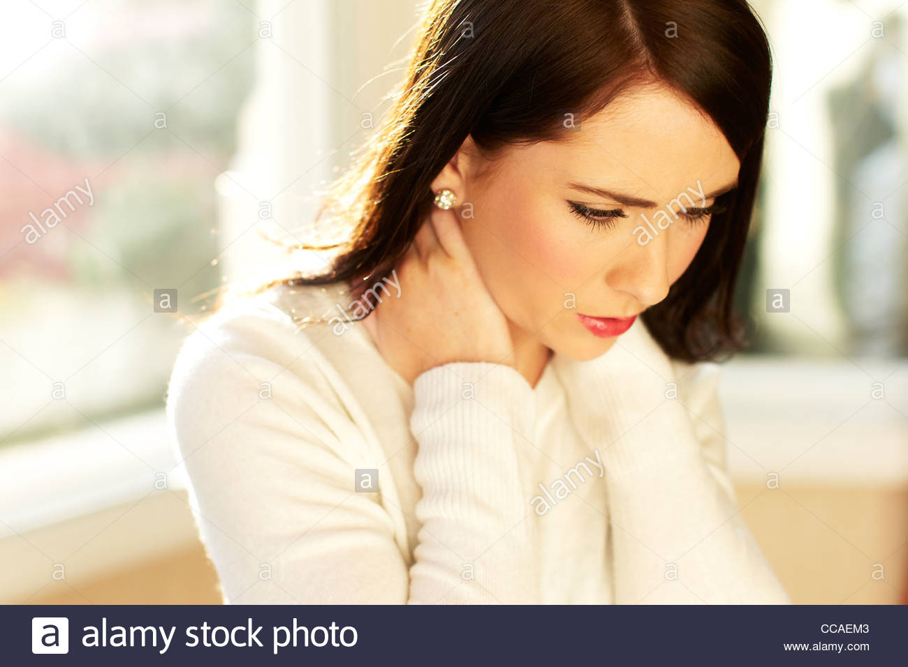 Girl massaging neck - Stock Image