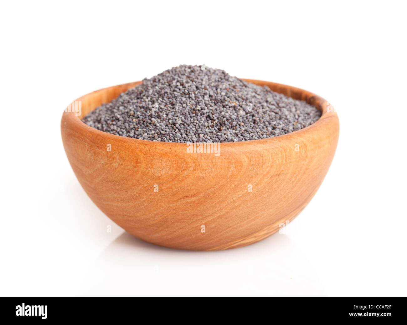 poppyseed in the wooden bowl. - Stock Image