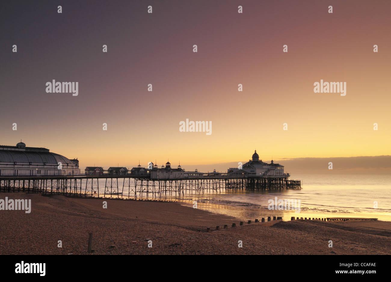 Eastbourne Pier dawn dusk sun rise set sunrise sunset sea seaside beach east Sussex England - Stock Image