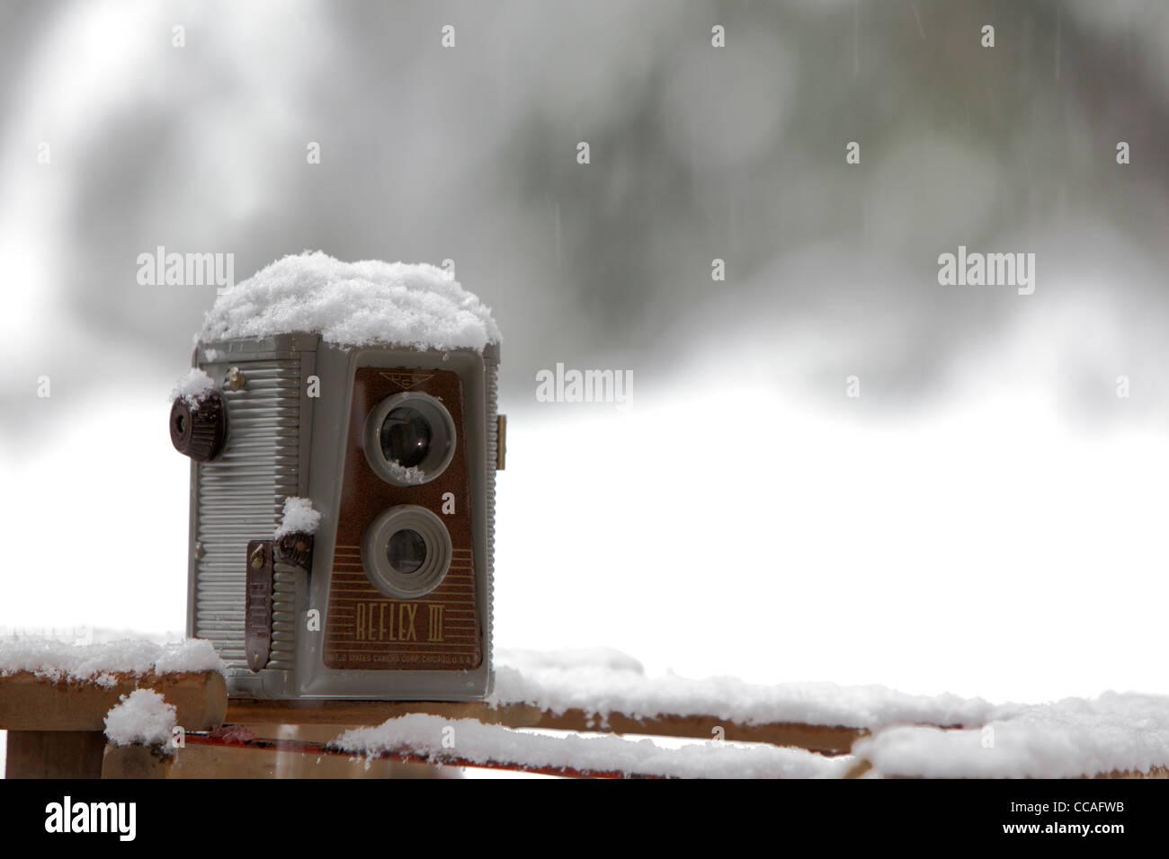 twin lens reflex camera in snow - Stock Image