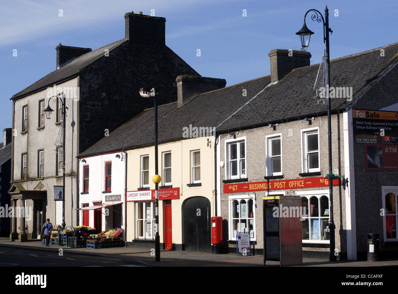 The main street of Bushmills, Coastal Road, County Antrim, Ulster, North Ireland, UK, Europe. - Stock Image