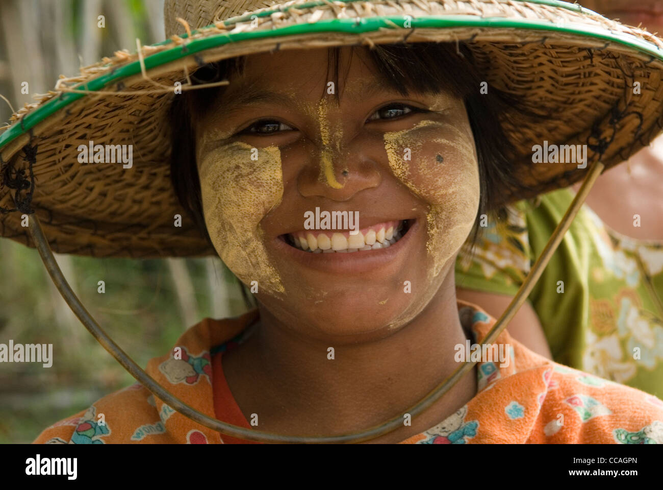 Teen girl wearing makeup Thanakha. A natural product, naturally produced. Myanmar Myanma Burma - Stock Image