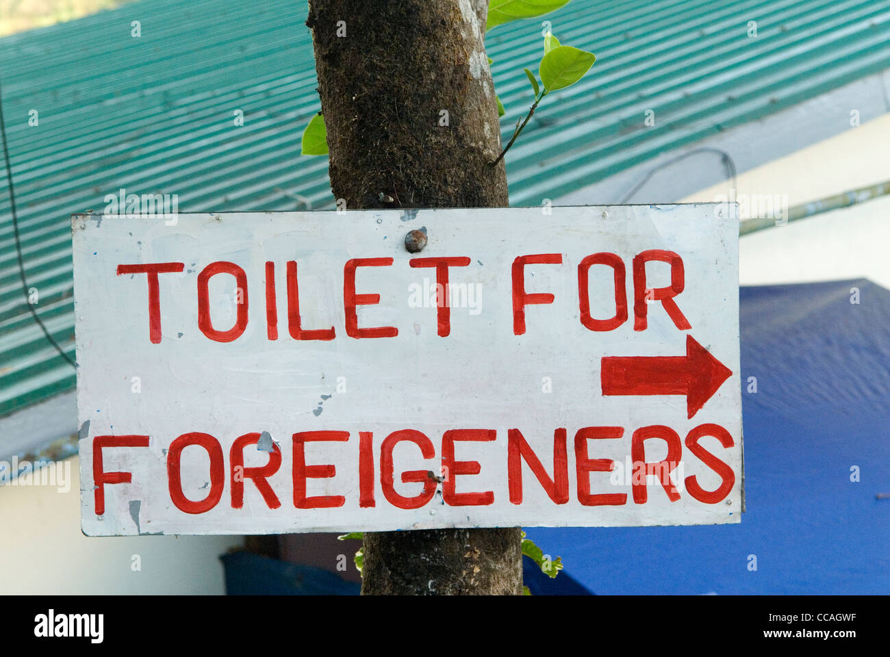 Toilets for Foreigeners sign Asia. Foreigners, tourists toilet WC lavatory - Stock Image