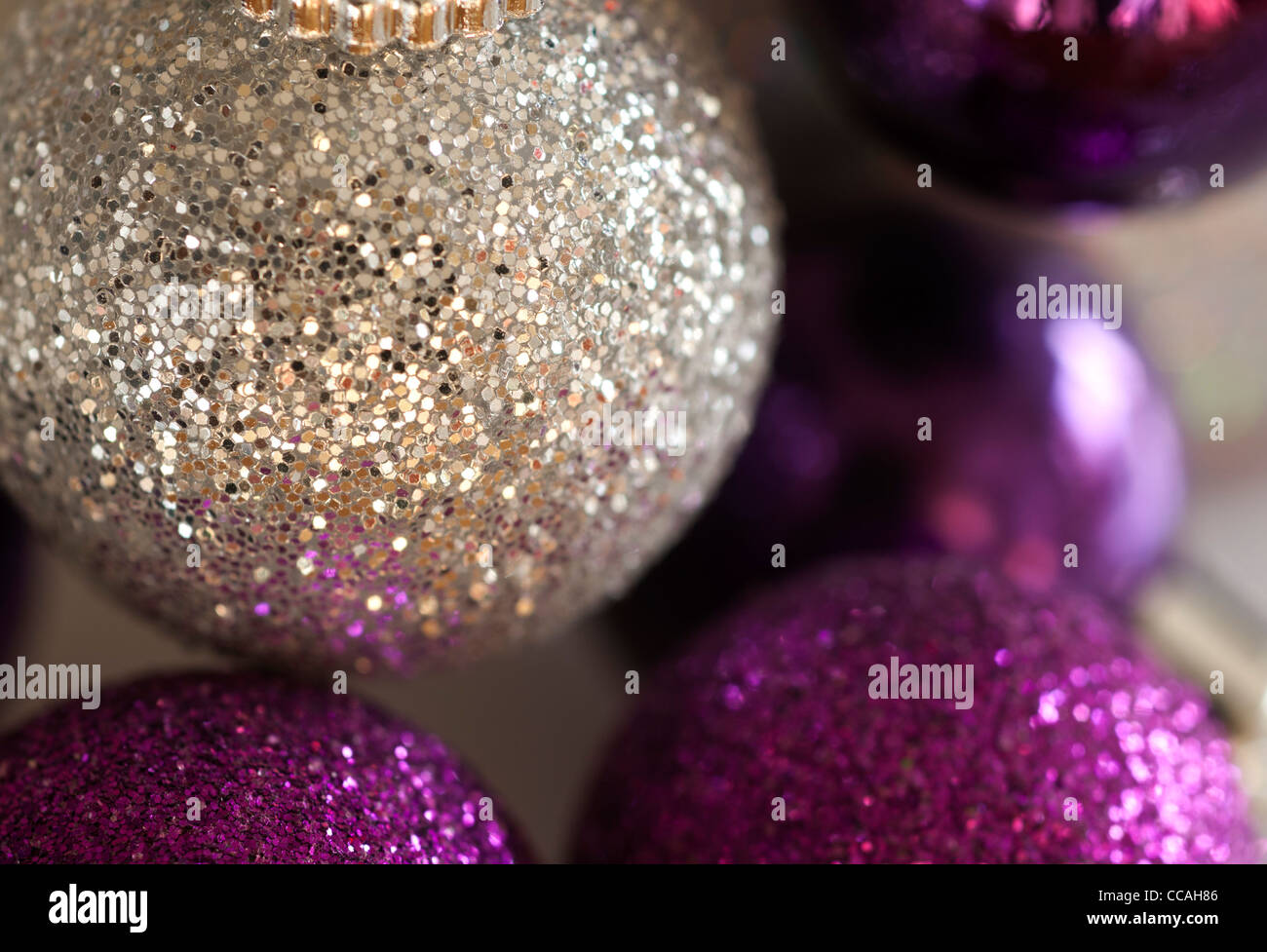 silver and purple glittery christmas tree decorations
