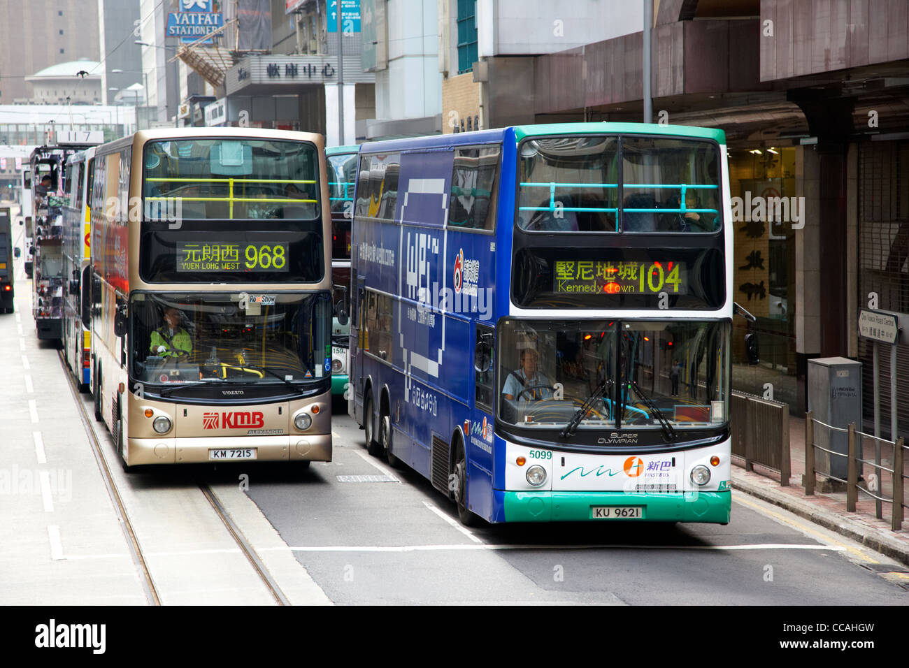 two modern double deck hong kong busses from different companies hksar china asia - Stock Image