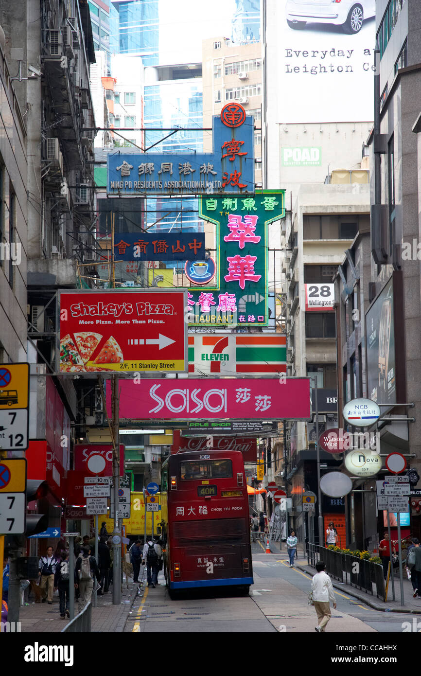 adverts advertising signs hanging over the street in lan kwai fong in the daytime hong kong hksar china asia - Stock Image