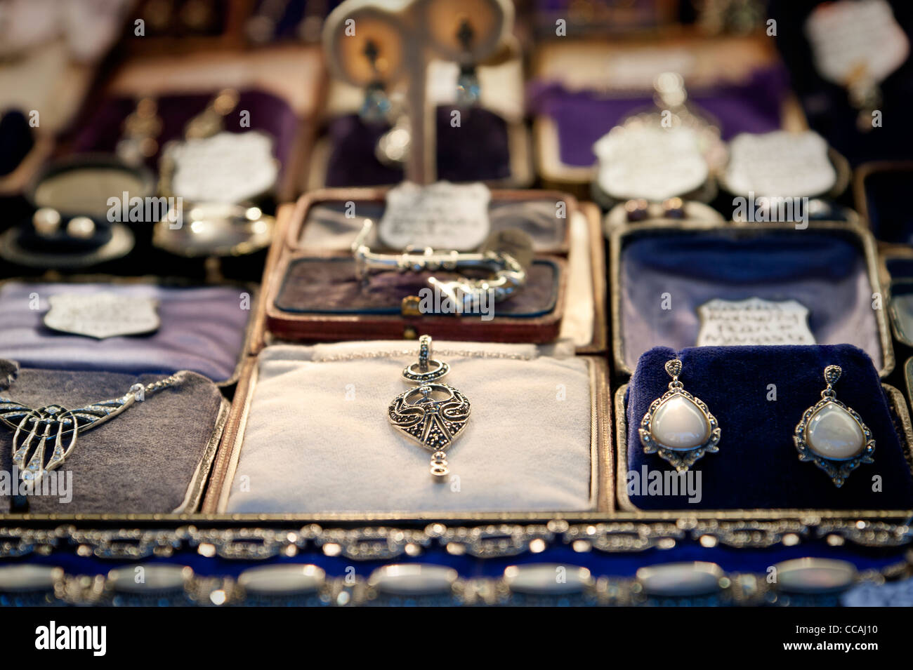 Beautiful secondhand jewellery in a shop window in Brighton lanes. East Sussex England UK - Stock Image
