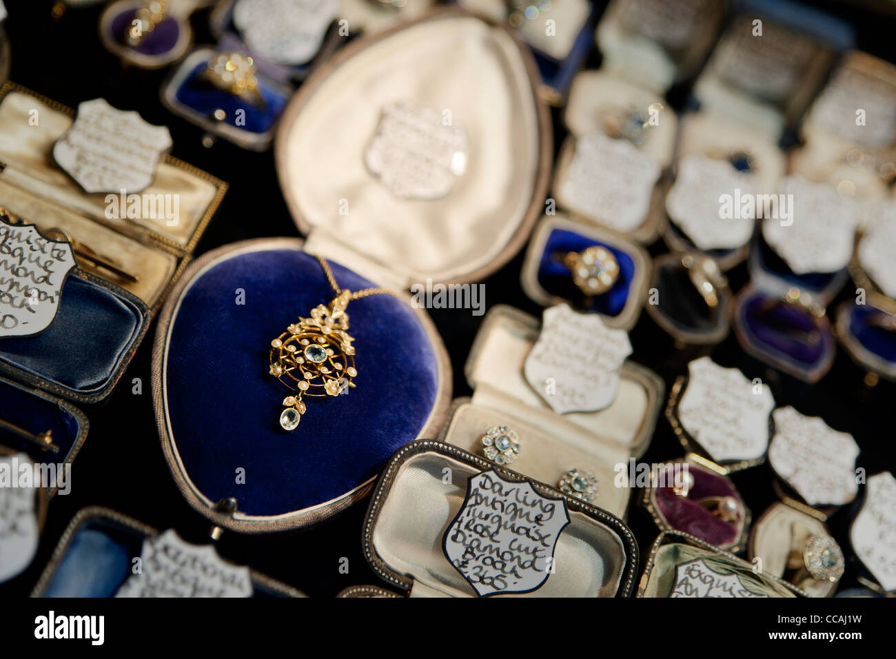 Beautiful secondhand jewellery in a shop window in Brighton Lanes, East Sussex England UK - Stock Image