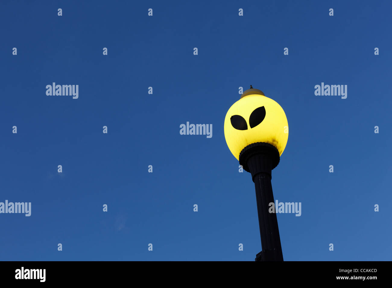 An extraterrestrial themed street light in Roswell, New Mexico. - Stock Image