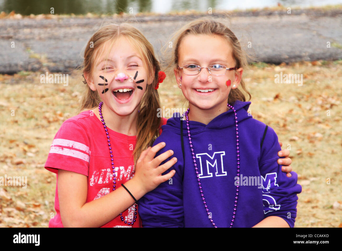 Smiling young girls with painted faces at Alzheimer's Memory Walk, Old River Park, Dayton, Ohio, USA. 26 September - Stock Image