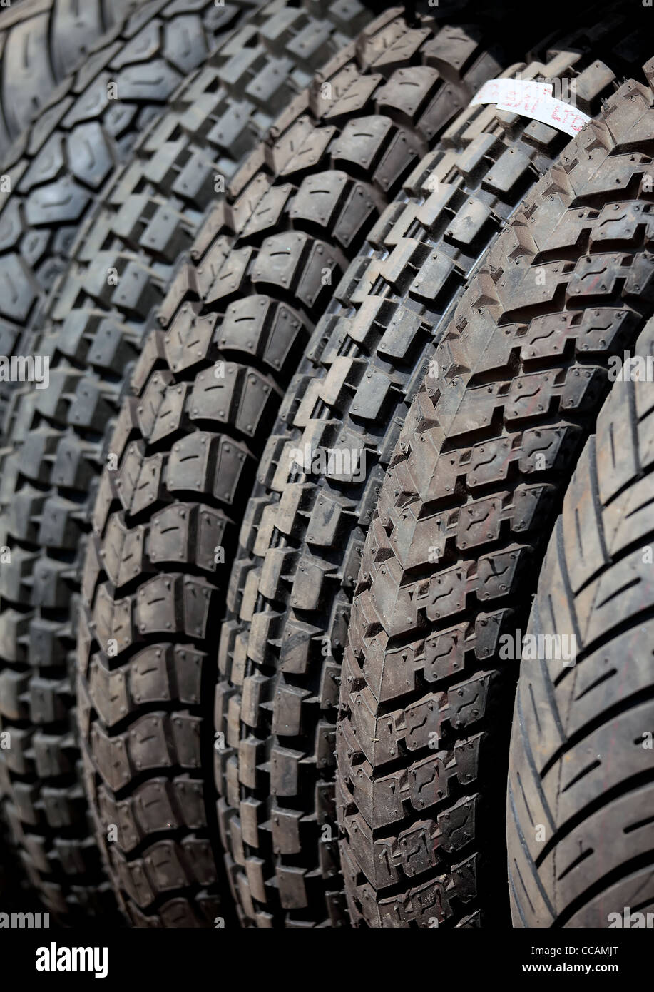 New, well-treaded heavy vehicle tyres.Rubber,tyres,automobile,accessory,treaded,tread - Stock Image