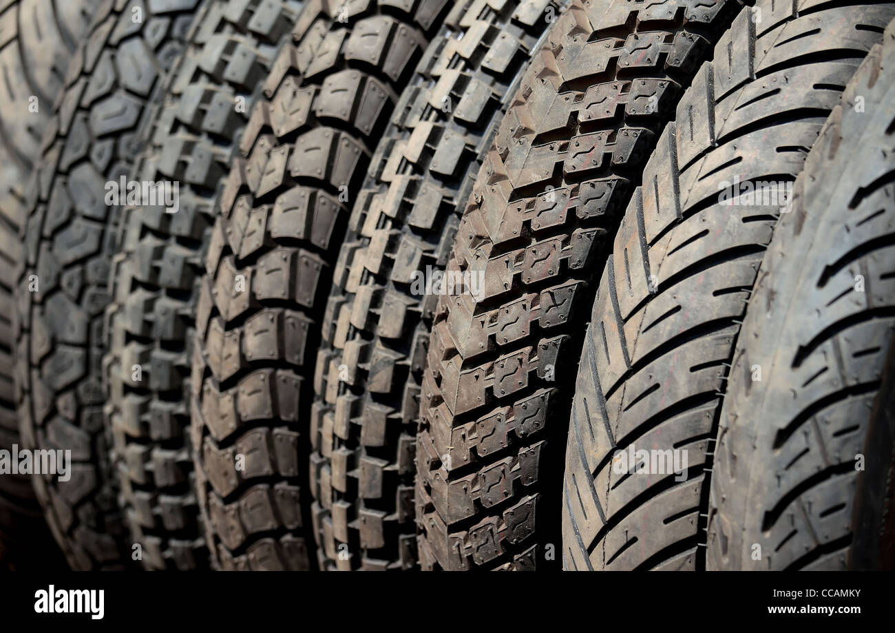 Rubber,tyres,automobile,accessory,treaded,tread,New, well-treaded heavy vehicle tyres. - Stock Image