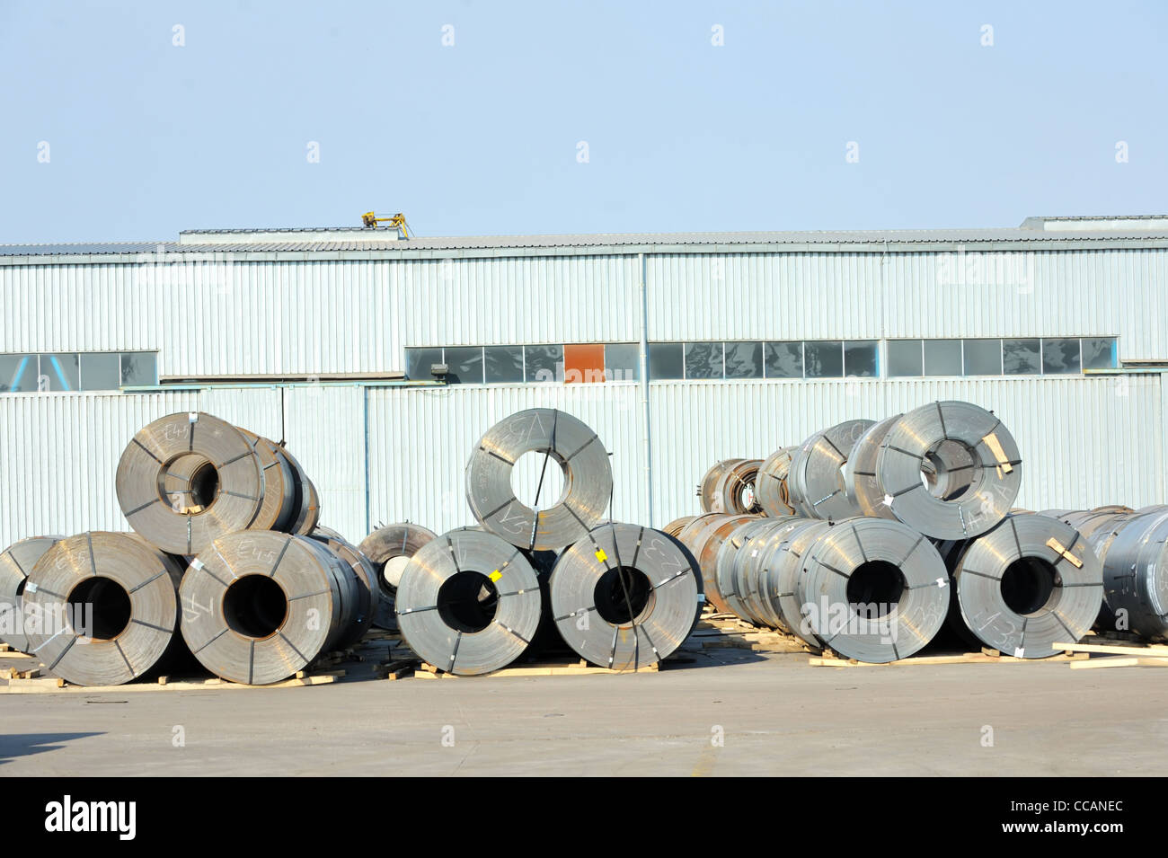 rolls of steel sheet in harbor Stock Photo