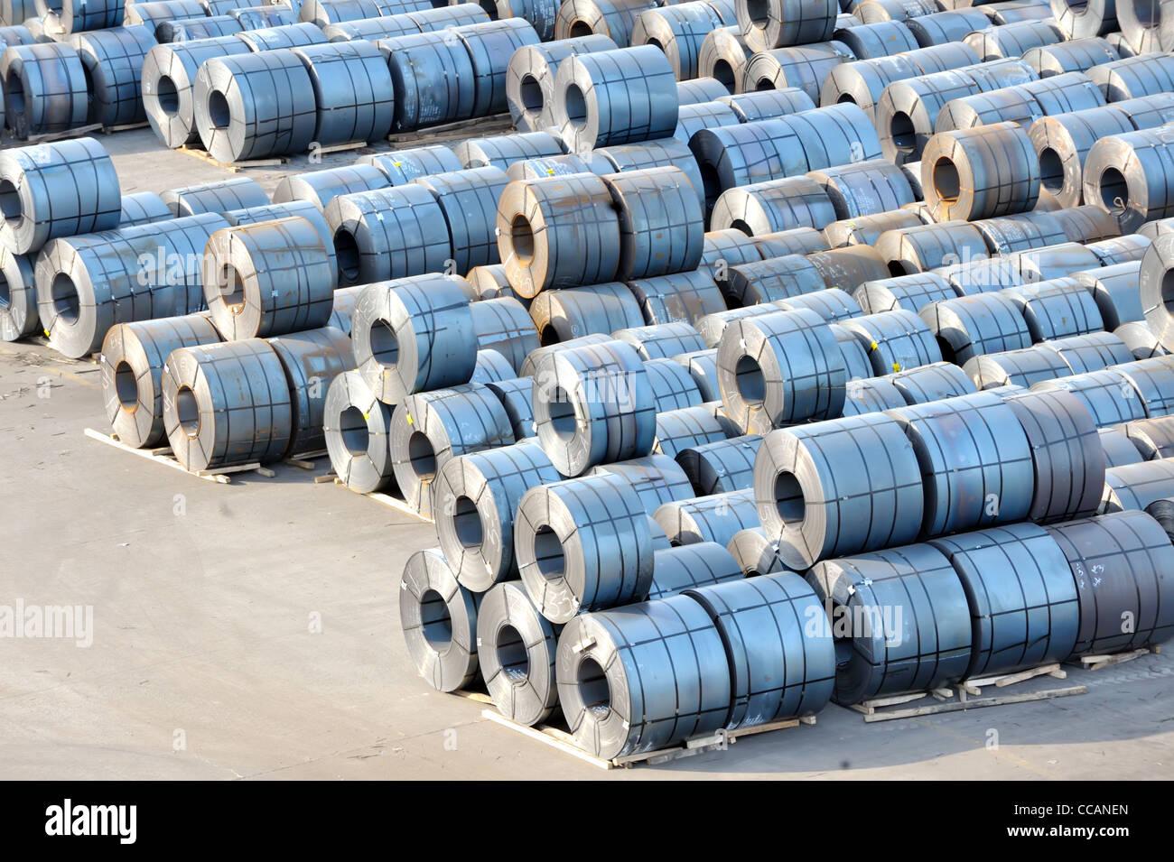 rolls of steel sheet in harbor Stock Photo