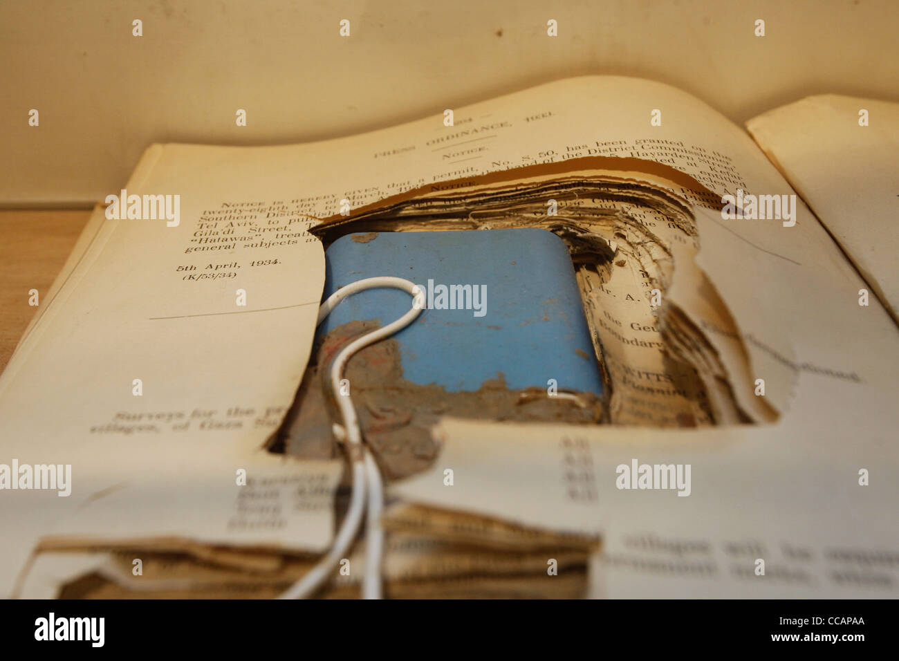 An exhibit depicting explosive device inside a book on display in the Lehi Museum, also known as Beit Yair, placed - Stock Image