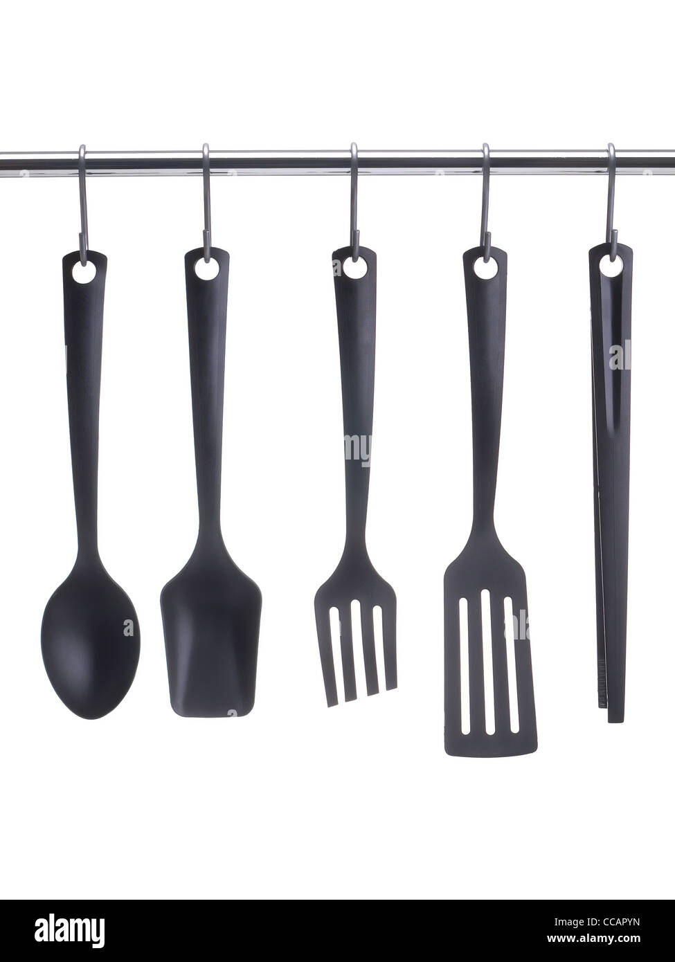 Black Plastic Kitchen Utensils Hanging On Metal Railing Over White  Background