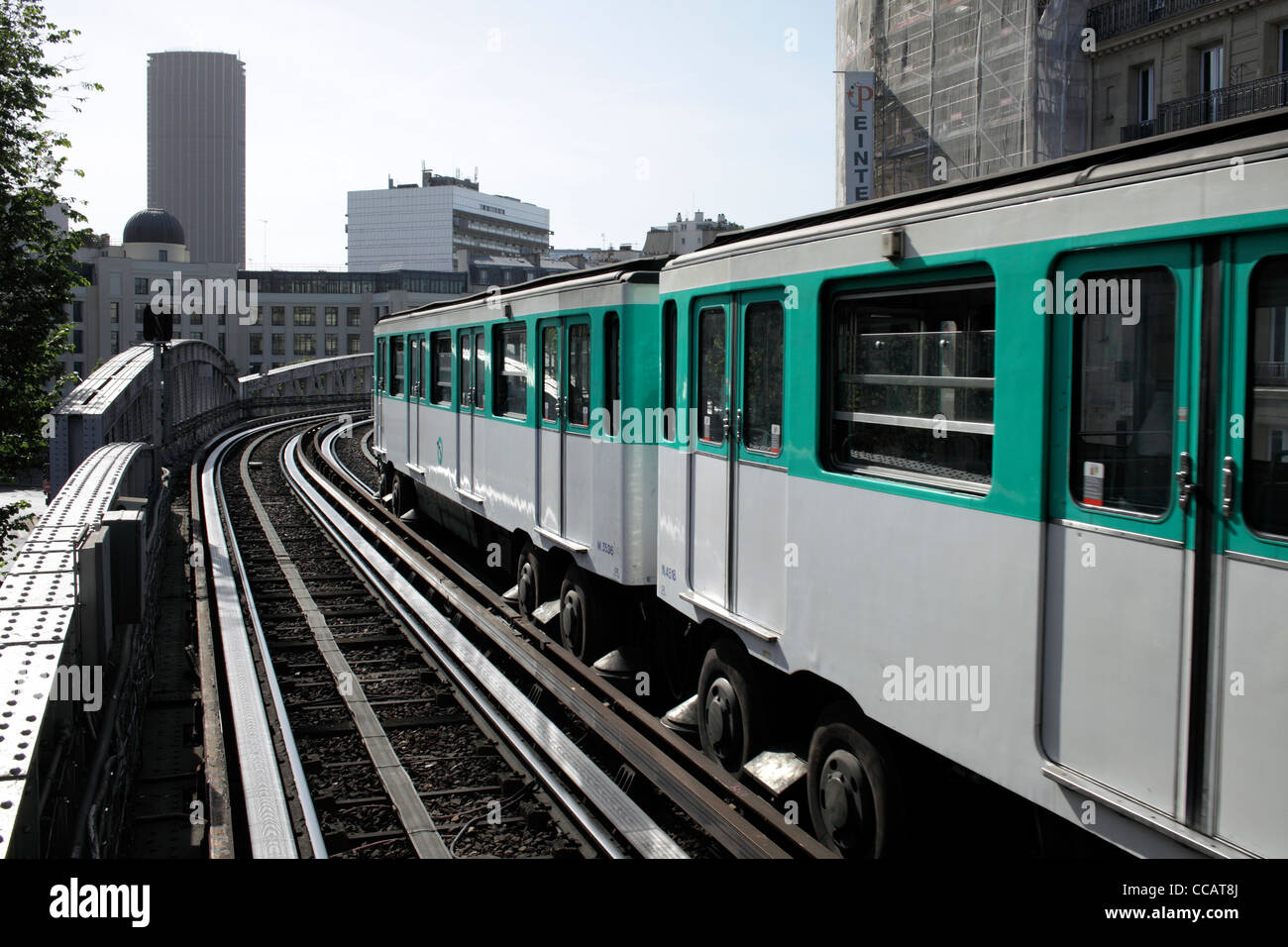 Metro train on Line 6 at Sevres Lecourbe station, Paris. Note rubber tyres on wheels and horizontal guide wheels. - Stock Image