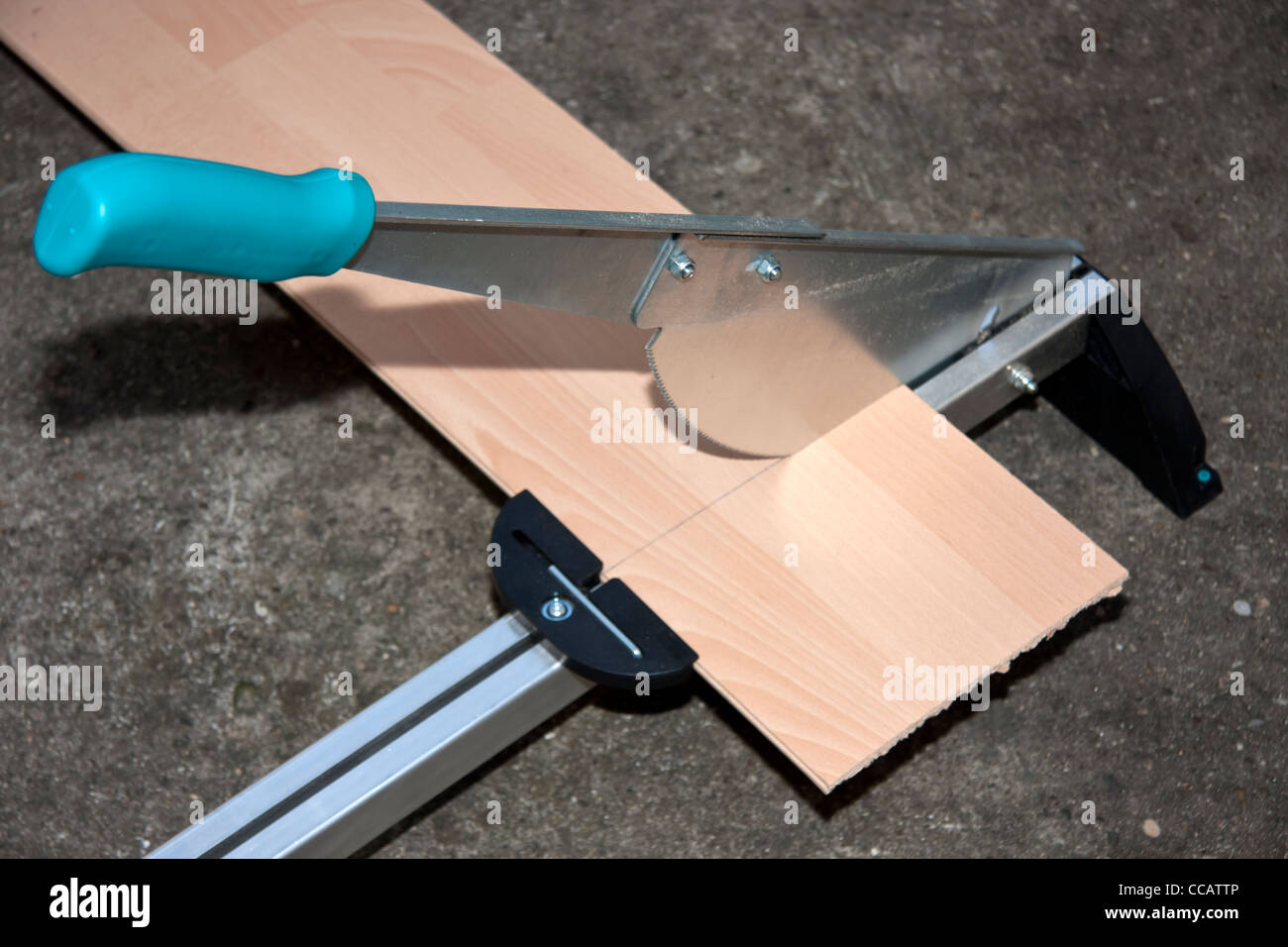 Cutting machine for laminate - Stock Image