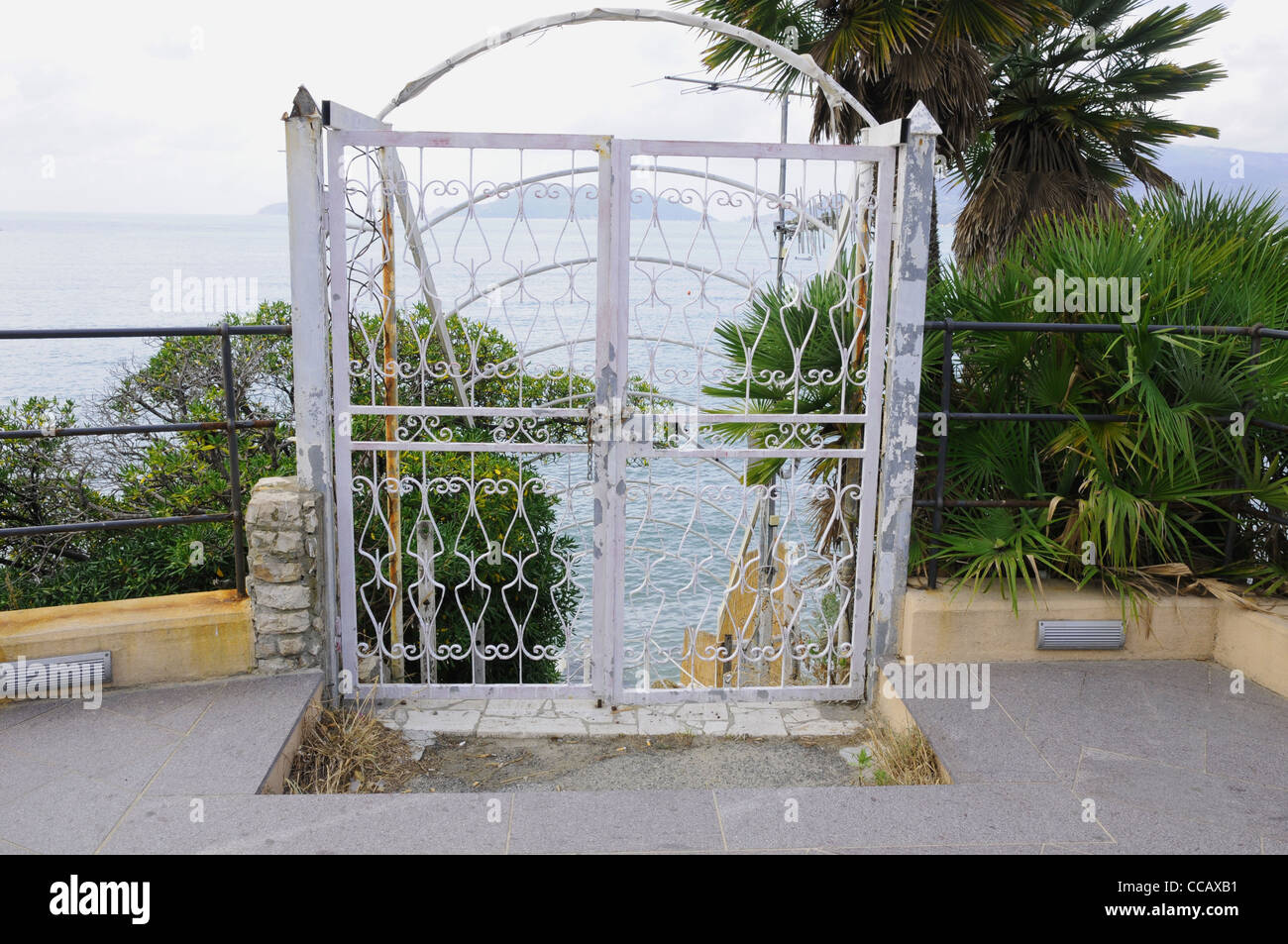white wrought iron gate, looking over bay of poets, Lerici, Liguria, Italy - Stock Image