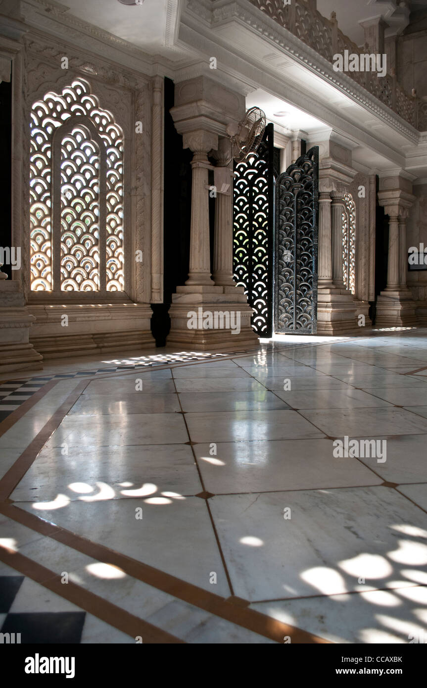 Latticed Windows and doors in the marble mausoleum, ISKCON, Krishna Balaram Mandir, Vrindavan, India Stock Photo