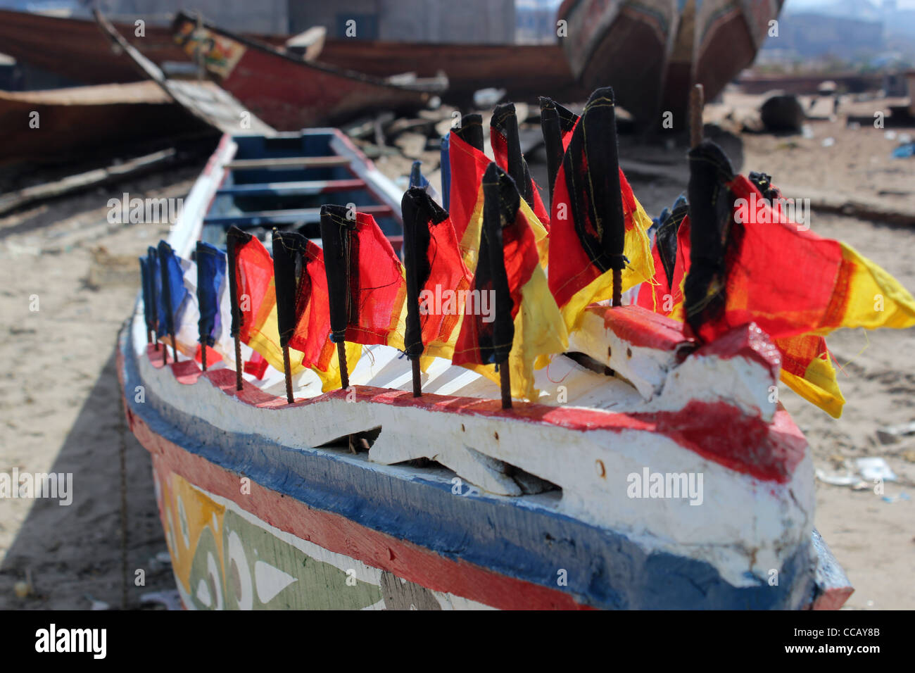 boats on beach at taji fishing village Gambia - Stock Image