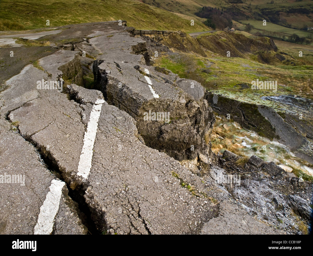 remains of tarmac road on slopes of Mam Tor, Castleton, Peak District National park, UK. The road was abandoned - Stock Image