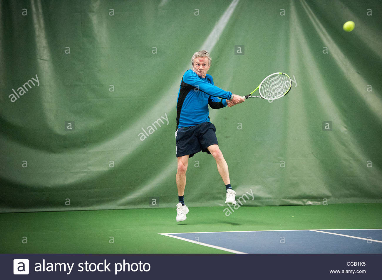 Indoor tennisplayer - Stock Image