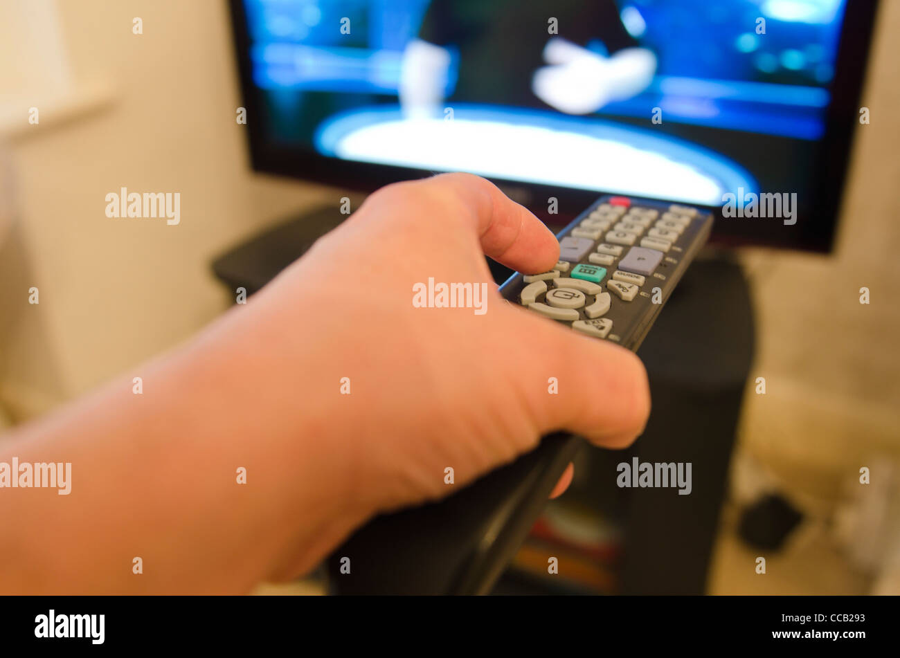 Using the tv remote control. Picture by Pete Gawlik. - Stock Image