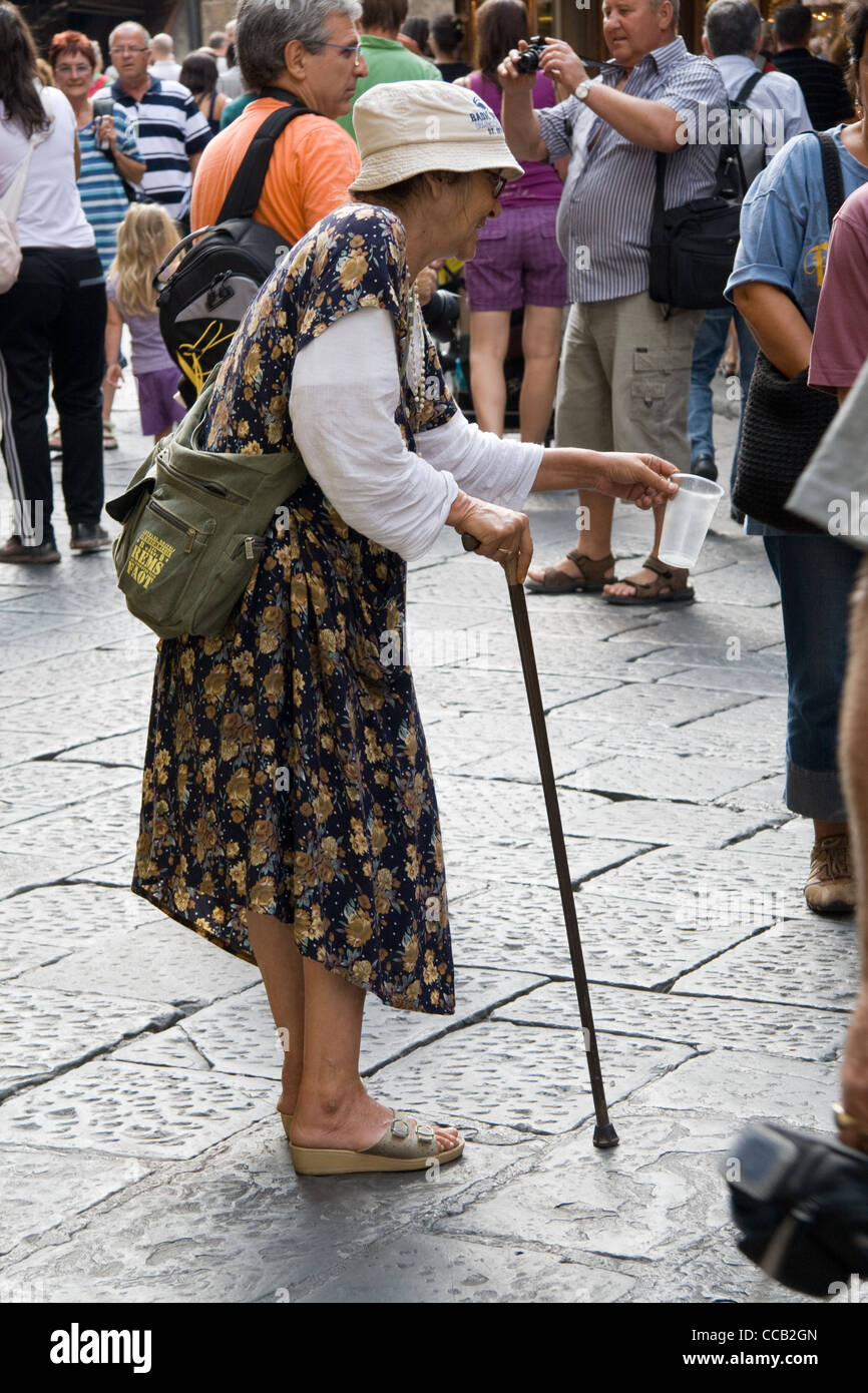 Old lady begging on Ponte Vecchio Bridge Florence - Stock Image