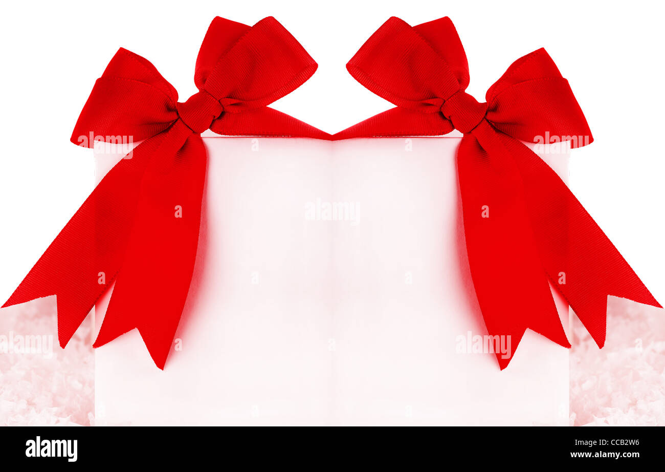 Beautiful red bows over blank greeting card, holiday concept - Stock Image