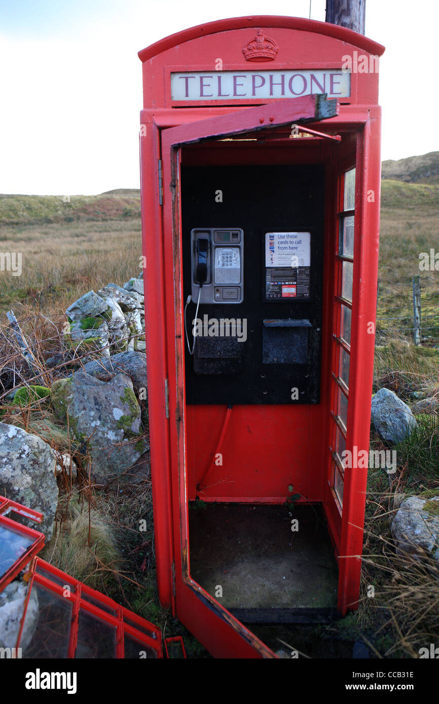 Damaged  rural telephone box - Stock Image
