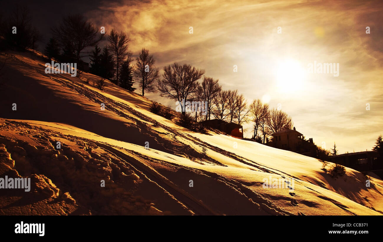 Winter sunset, beautiful mountains landscape, village covered with snow, cold weather wintertime seasonal nature, - Stock Image