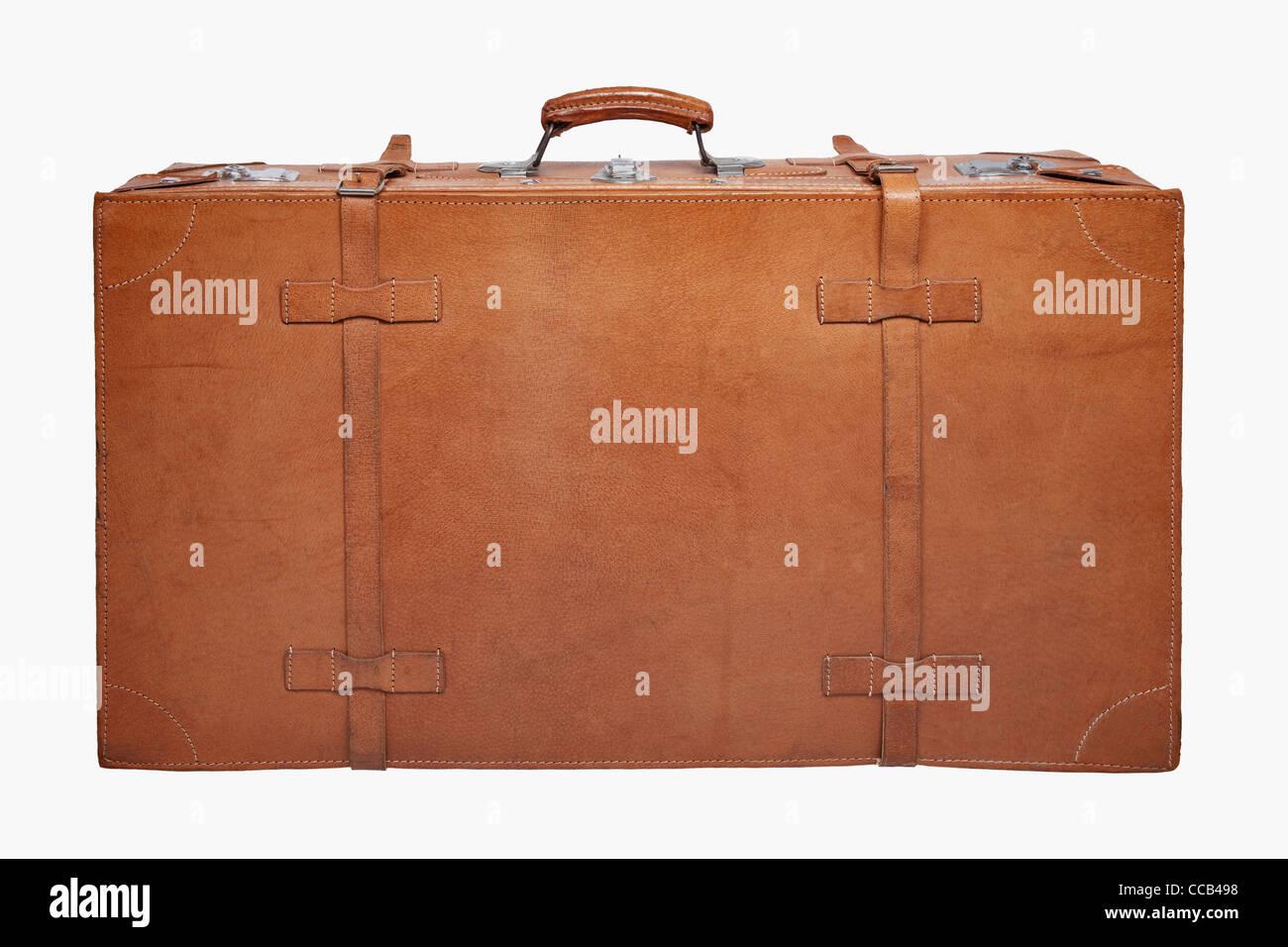 Detailansicht eines stehenden, alten braunen Lederkoffers   Detail photo of a old brown leather suitcase, upright - Stock Image