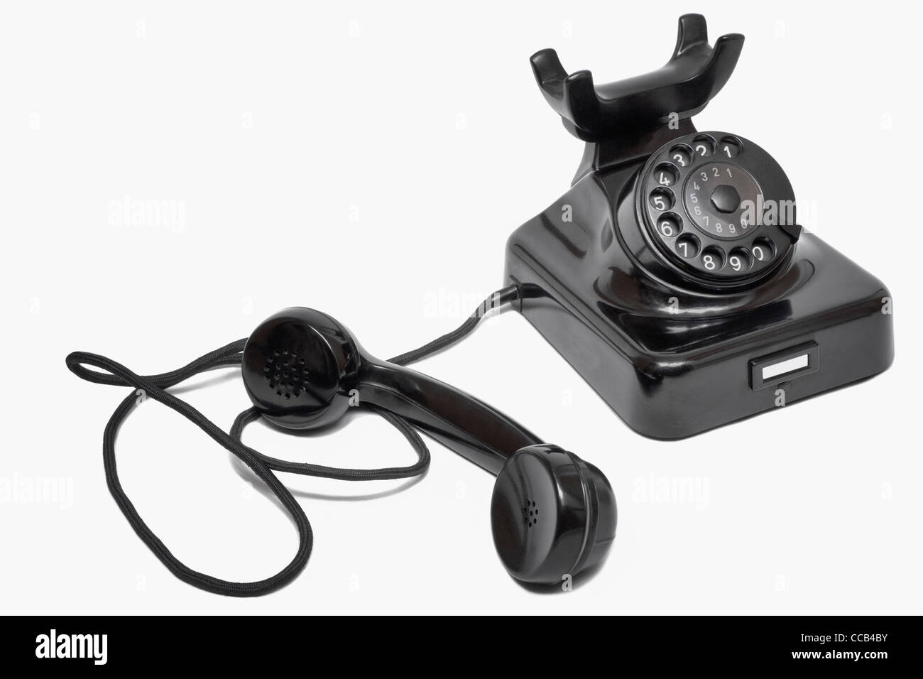 Detail photo of a old black telephone, alongside is the telephone receiver - Stock Image