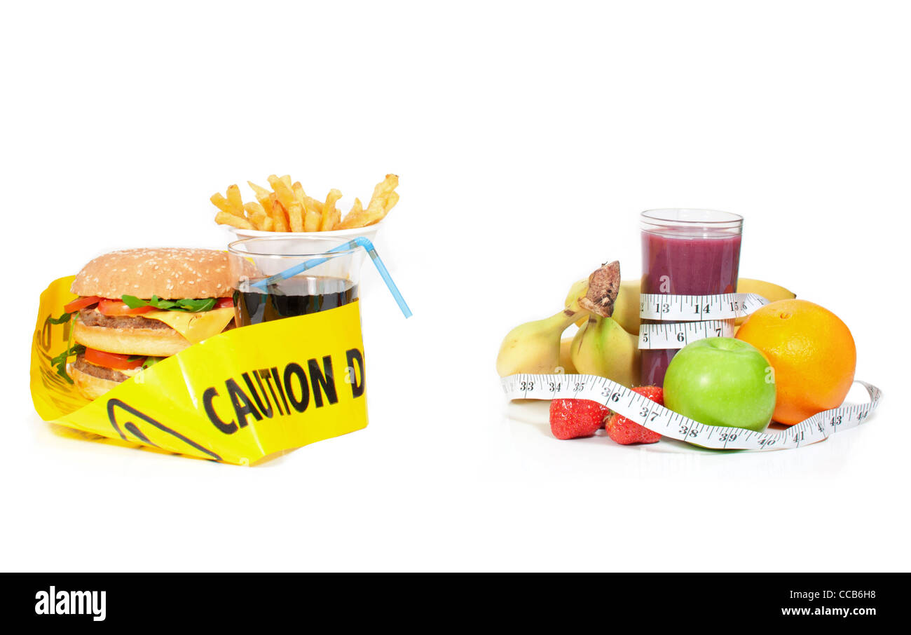 Lifestyle choice between junk food surrounded with a caution tape and fruits with a tape measure - Stock Image