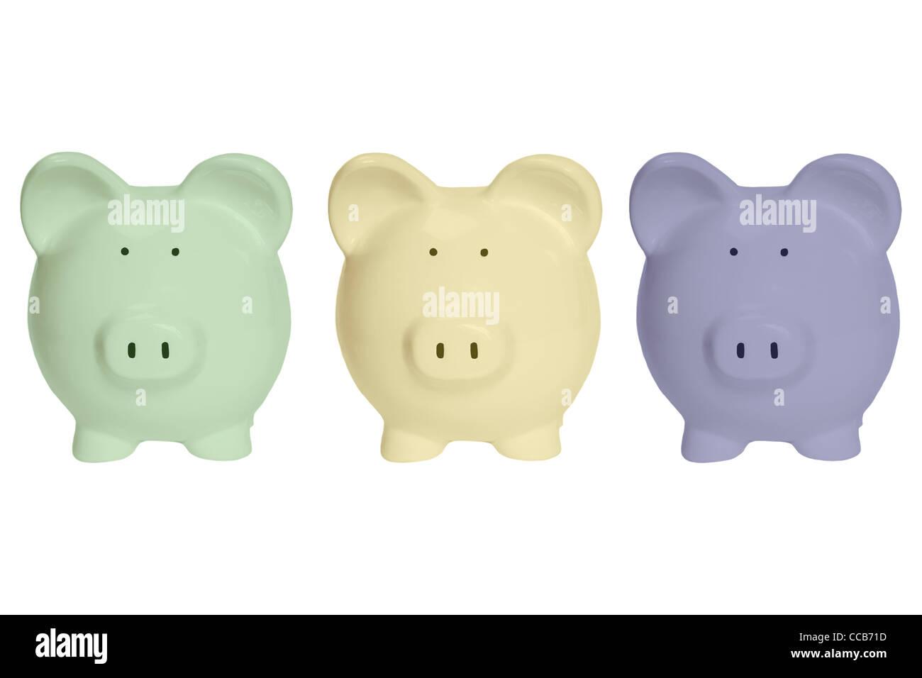 Detailansicht von drei bunten Sparschweinen | Detail photo of three colored piggy banks - Stock Image