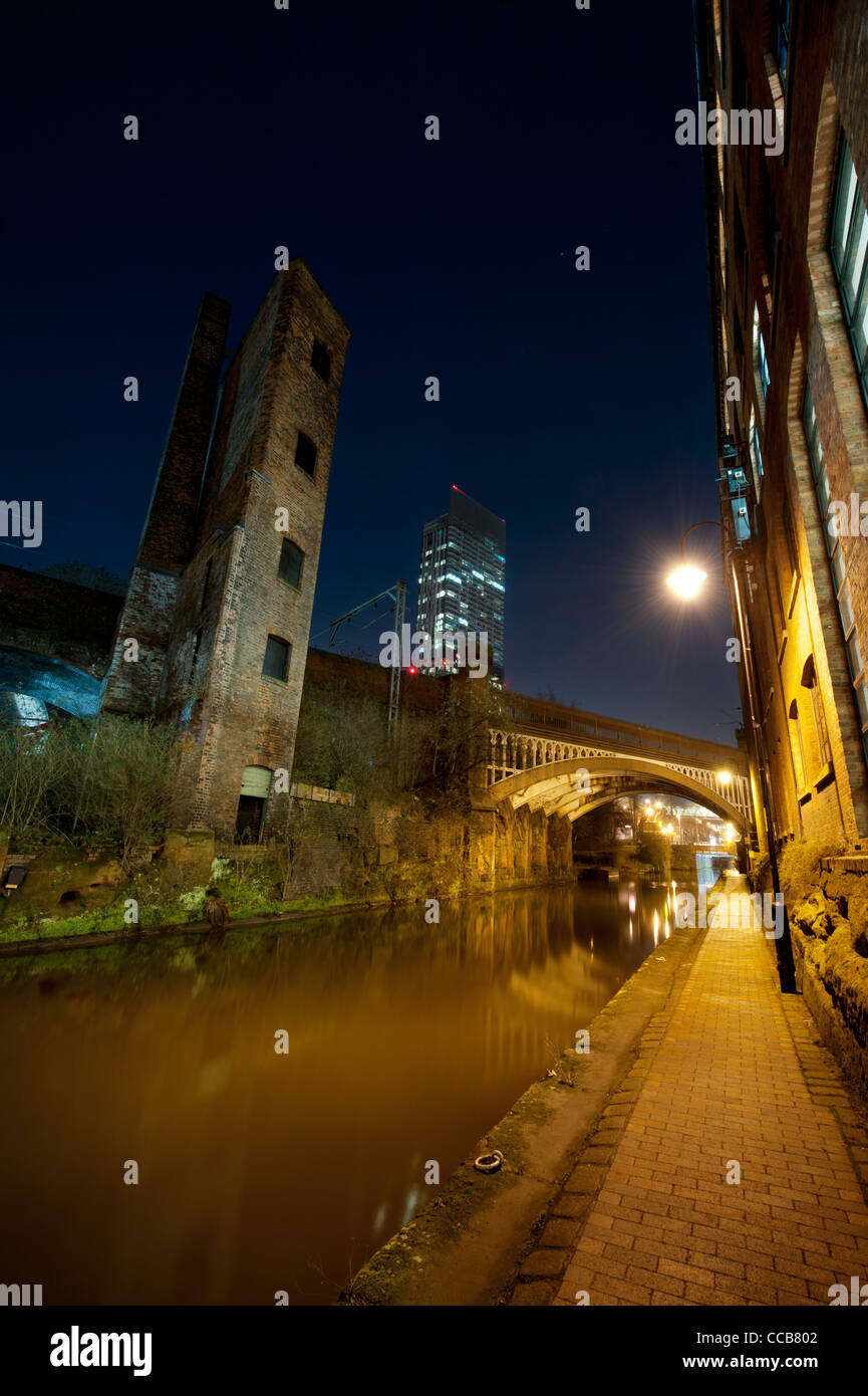 A night shot of canal at Castlefield, Manchester with Beetham Tower in the background. - Stock Image