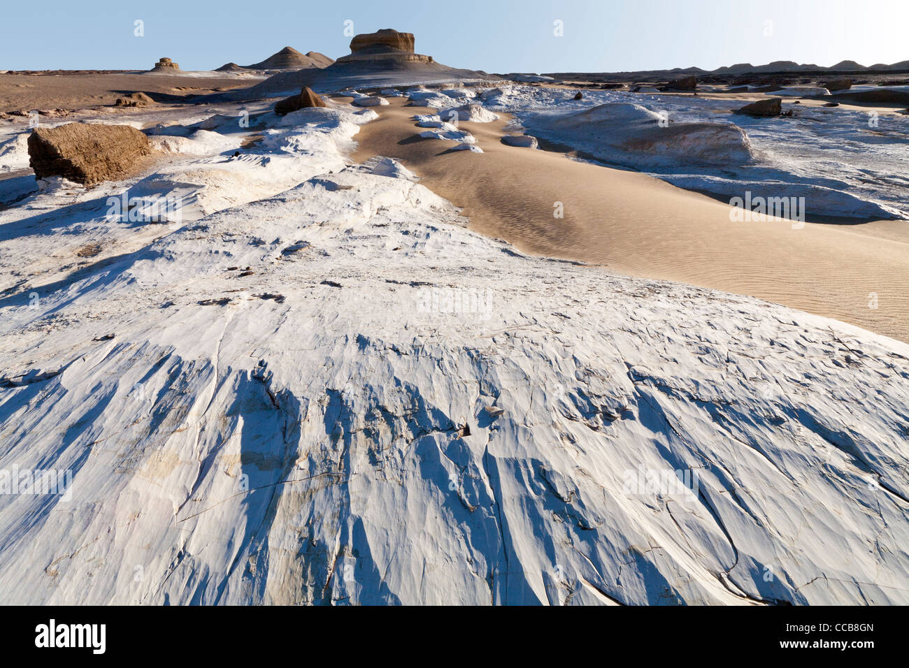 White limestone intrusion on edge of yardang field Dakhla Oasis Egypt  Africa - Stock Image
