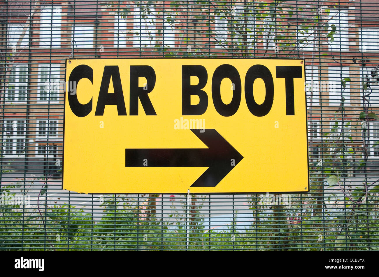 A yellow sign pointing to the Car Boot Sale, at Princess May Primary School, Stoke Newington, Hackney, London. - Stock Image