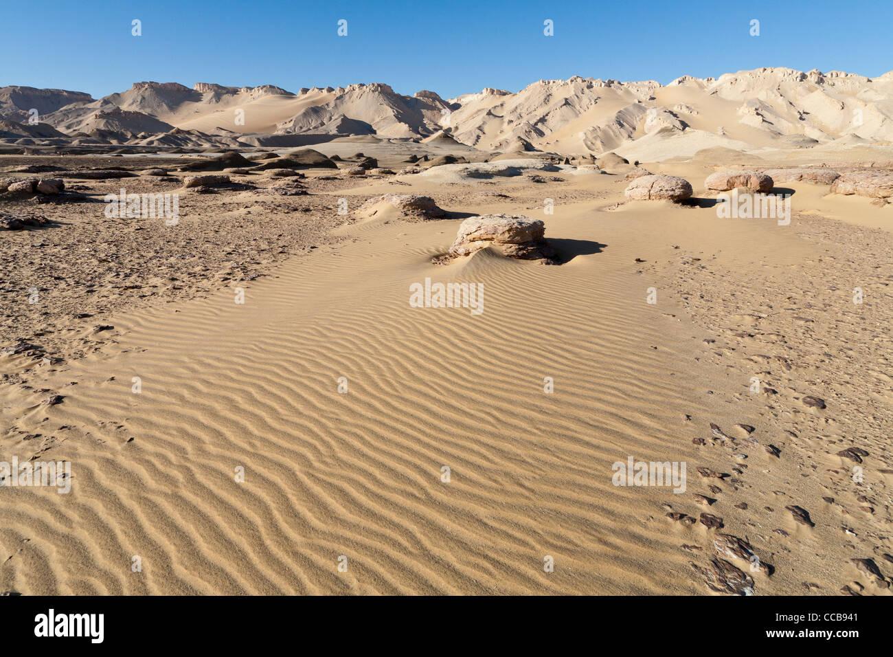White limestone intrusion on edge of yardang field Dakhla Oasis Egypt  Africa - Stock Image