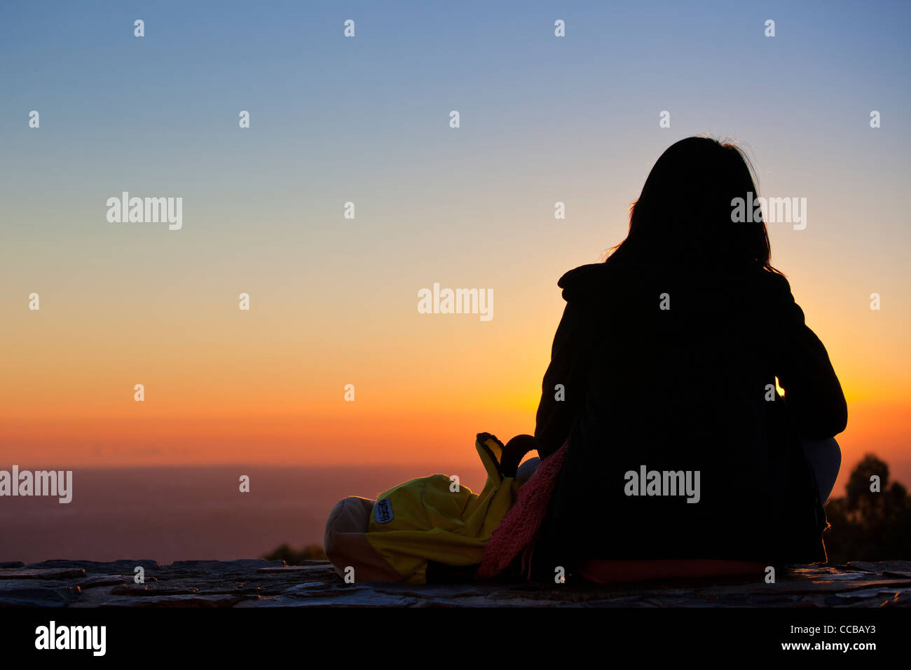 woman Backpacker sunset sunrise silhouette view Australia over Yarra valley from skyhigh platform Dandenong ranges - Stock Image