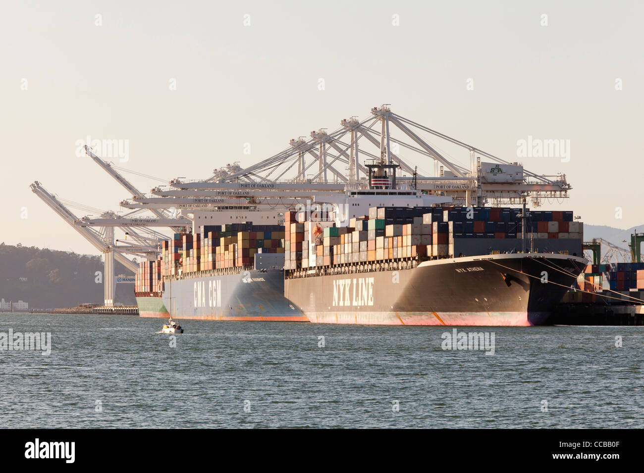 Container ships wait to get unloaded at the Port of Oakland - California USA - Stock Image