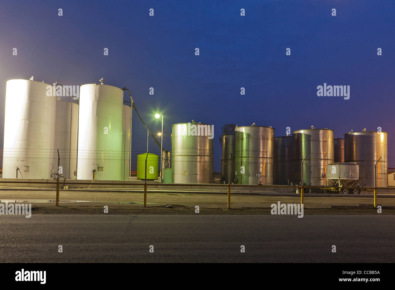 Industrial size stainless steel chemical tanks - Stock Image