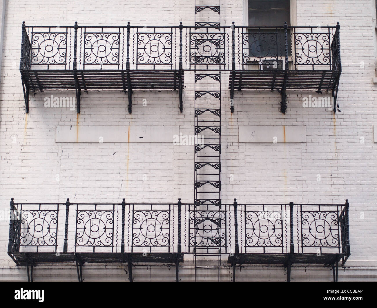 wrought iron spindle with interesting wrought iron.htm wrought iron fire escape stock photos   wrought iron fire escape  wrought iron fire escape stock photos