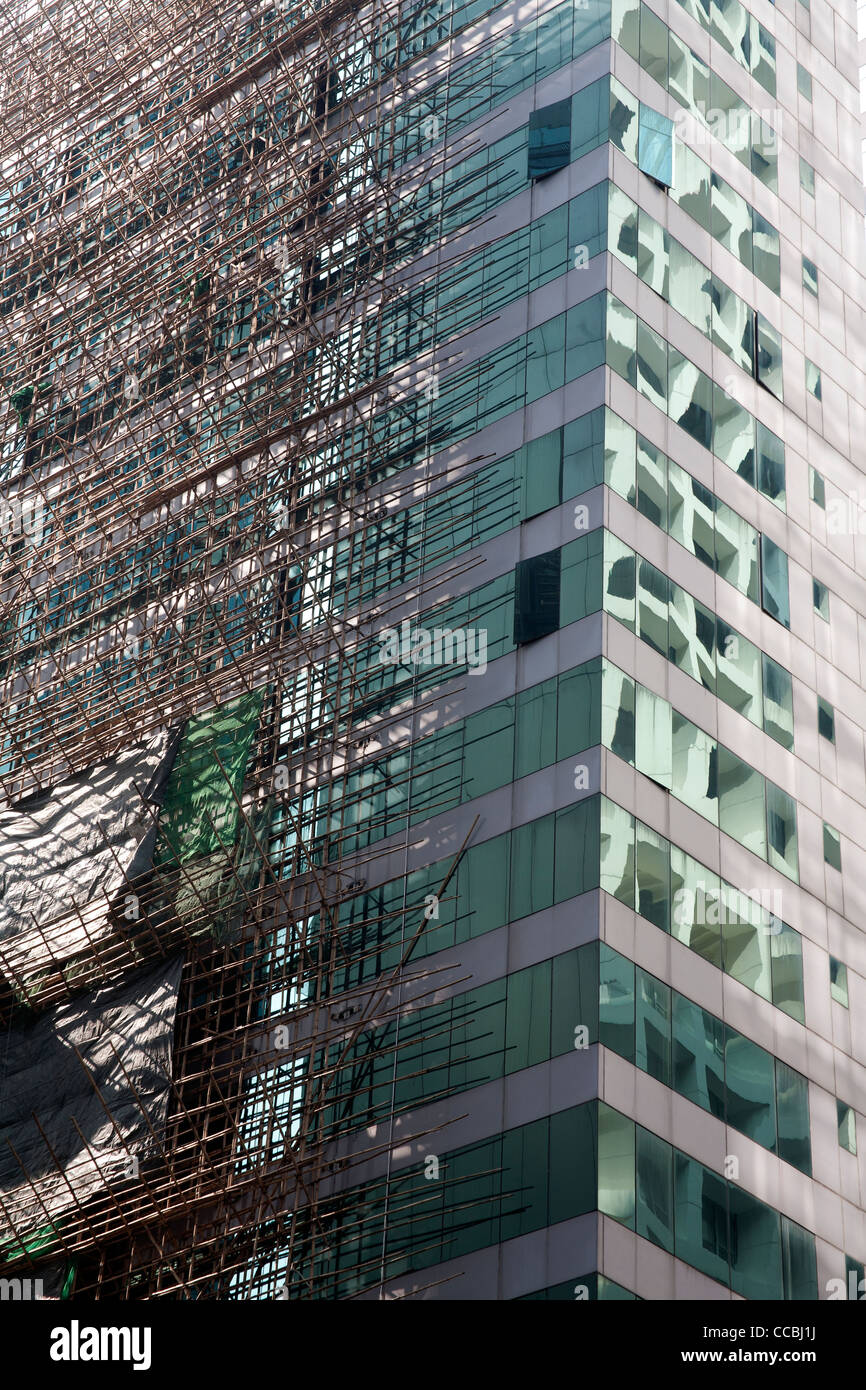 Office block with bamboo scaffolding in the Central business district of Hong Kong Hong Kong Island, SAR China - Stock Image