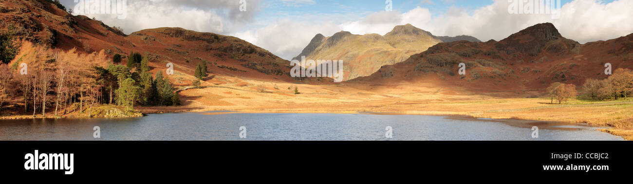 The Langdale Pikes and Side Pike as seen from Blea Tarn in late autumn Stock Photo