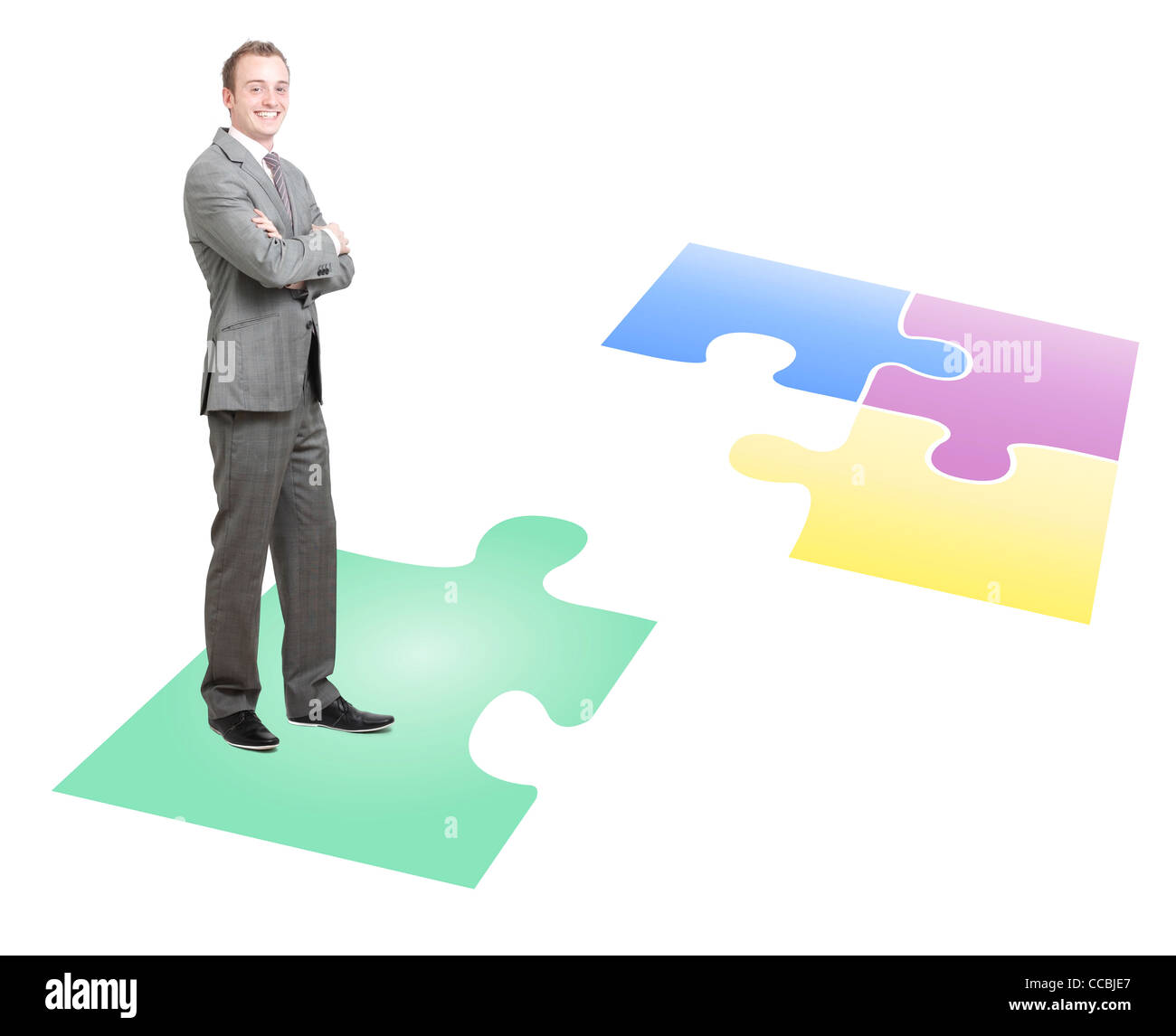 Businessman solving a puzzle - Stock Image