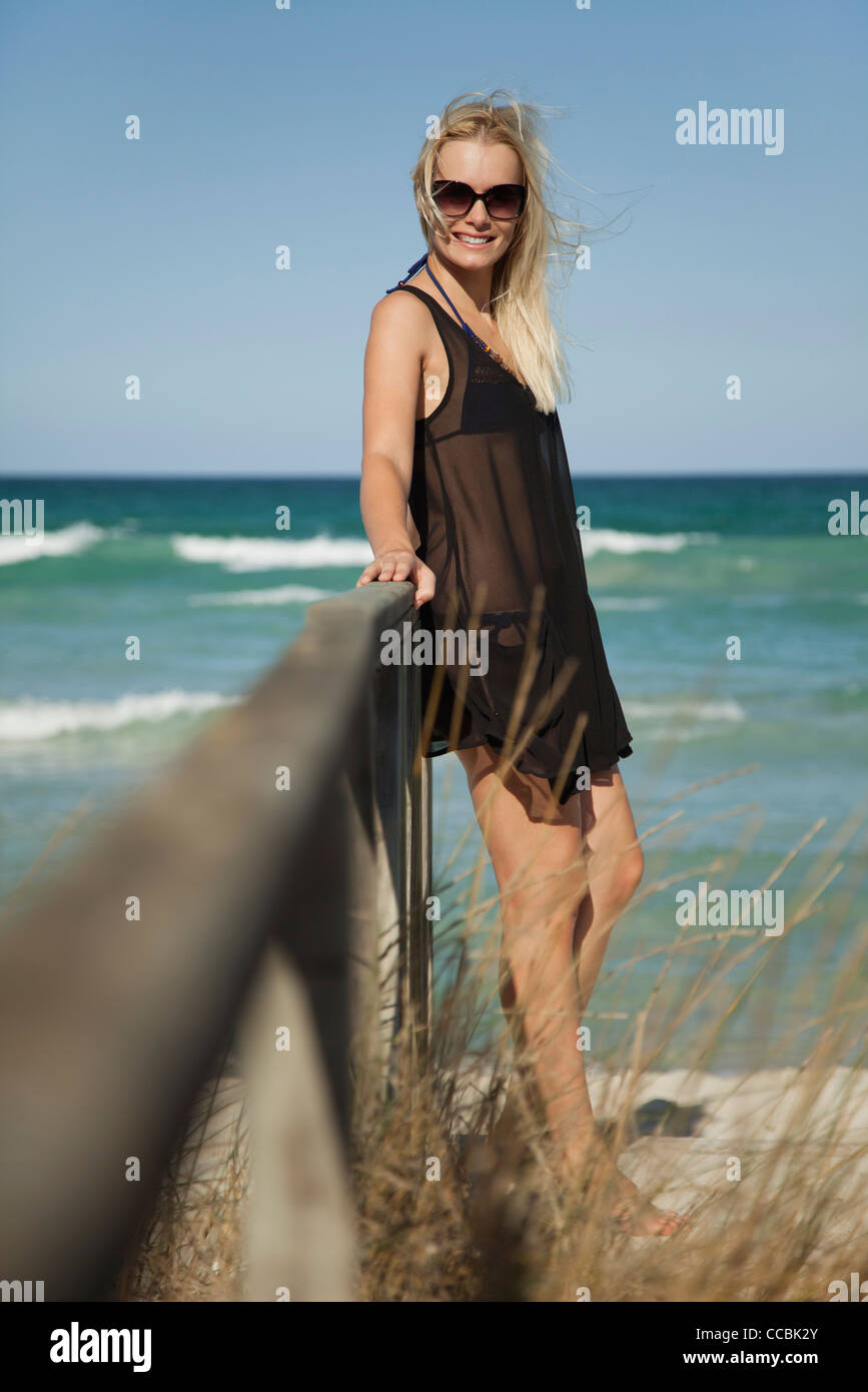Woman relaxing at the beach - Stock Image