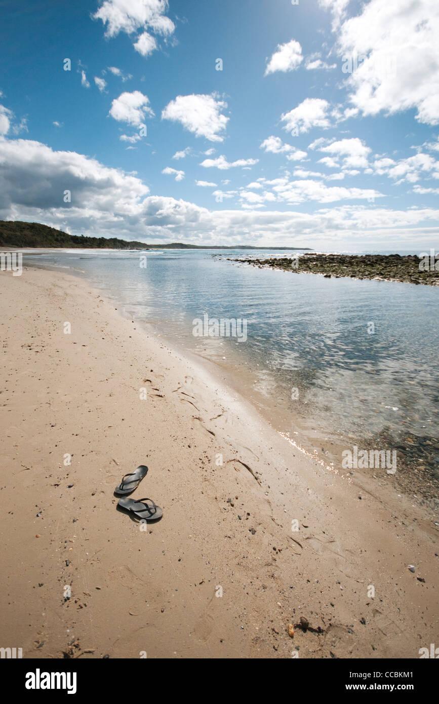 Flipflops left on beach - Stock Image