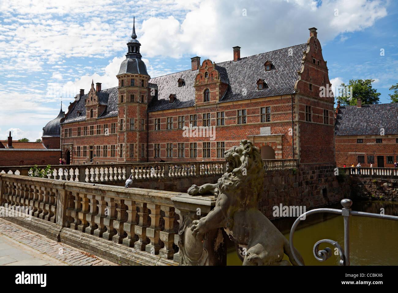 The Frederiksborg Castle in Dutch Renaissance style and the bridge over the moat in Hillerød near Copenhagen, Denmark Stock Photo